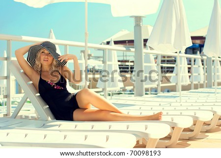 Series the beautiful woman has a rest on the yacht - stock photo
