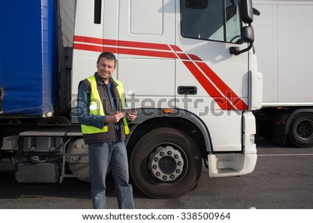 Serious and confident Man standing in front of truck #338500964