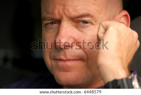 Serious And Tough Looking Man With Furrowed Brow Stock Photo ...
