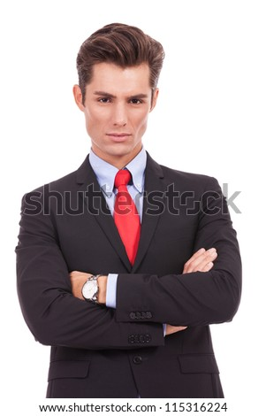 serious and young business man posing with crossed arms