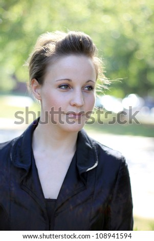Serious Attractive Young Woman Looking Away From Camera