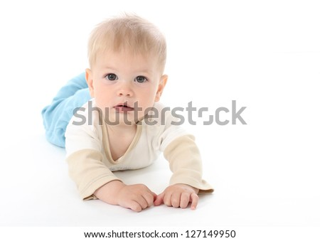 Serious baby on white background, isolated, tummy time