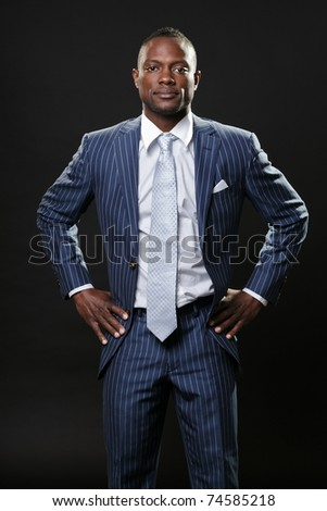 Serious black young business man in suit.