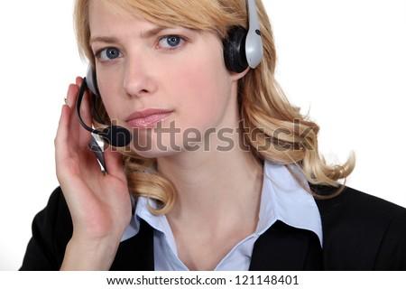 Serious blond call-center worker