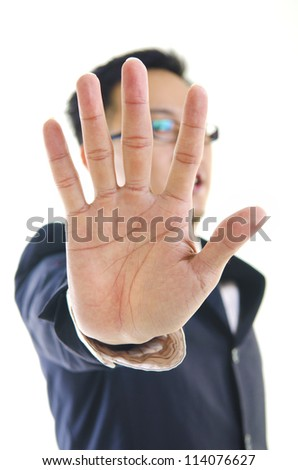 Serious business man making stop sign over white background. Focus on hand