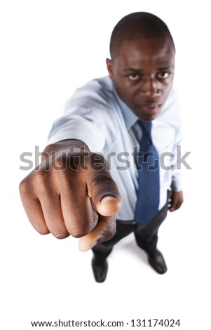 Serious business man pointing to you (focus on his finger) - stock photo