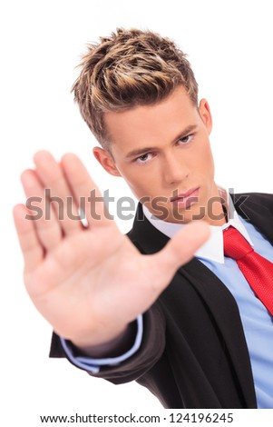 serious business man showing stop gesture on white background - stock photo