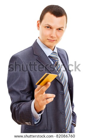Serious businessman in suit with tie standing and holding gold plastic card isolated on white background. Mask included