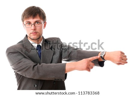 Serious businessman pointing on his wirstwatches over white background