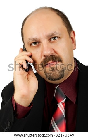 Serious businessman talking by mobile phone, and receiving bad news, isolated on white background