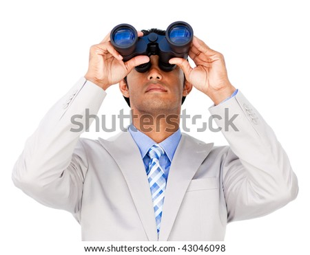 Serious businessman using binoculars isolated on a white background