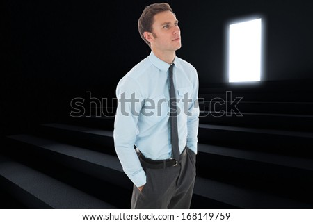 Serious businessman with hands in pockets against steps leading to light in the darkness
