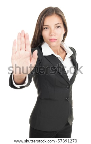 Serious businesswoman making stop sign on white background, focus on business woman.