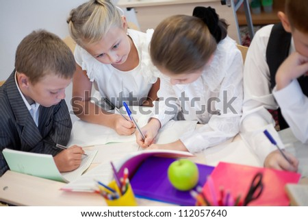 Serious children writing task in the school
