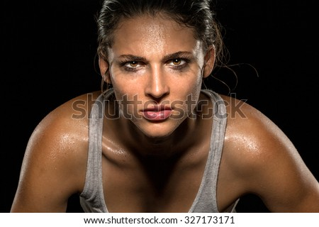 Serious confident stare champion athlete wrestler exercise trainer conviction focused powerful modern female