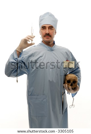 Serious doctor holding a syringe in his right hand and scull in his left hand