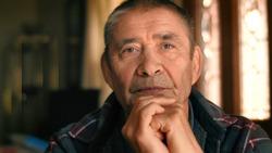 Serious elderly man thinking, looking at camera, closeup portrait. Shallow DOF.