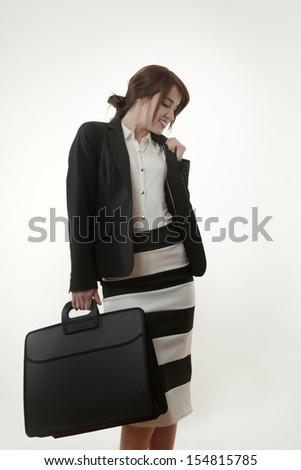 Serious elegant businesswoman holding briefcase
