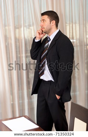 Serious executive man have a call on phone mobile in a meeting room - stock photo