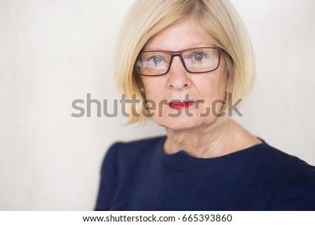 Shutterstock Serious face of senior businesswoman in glasses