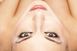 serious female face and eyes with false eyelashes