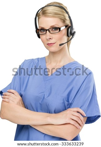 Serious female nurse with light blond hair in uniform with arms crossed talking on headset - Isolated