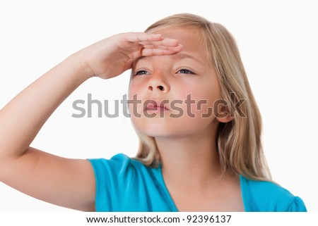 Serious girl looking ahead against a white background - stock photo