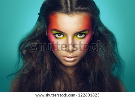 serious girl with eye shadows on face