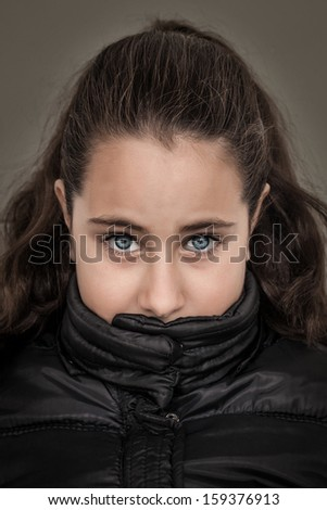 Serious Girl with Her Mouth Covered