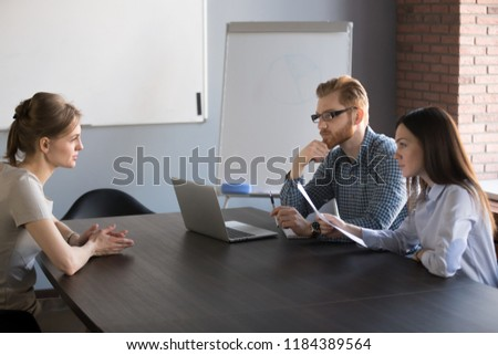 Serious hr attentively listening candidate talking at job interview, focused human resources staffing managers recruiting applicant at hiring negotiations, first impression and employment concept