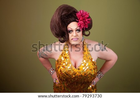 Serious large drag queen with hands on hips