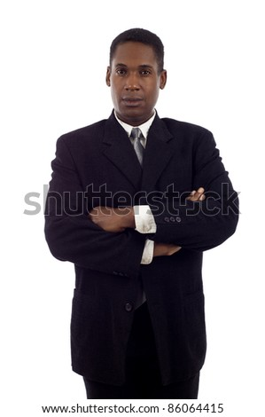 Serious looking African American business man standing with hands folded isolated white background
