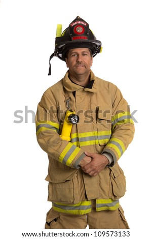 Serious looking confident firefighter standing portrait isolated on white