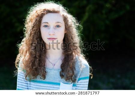 stock-photo-serious-looking-teenage-girl-closeup-281871797.jpg