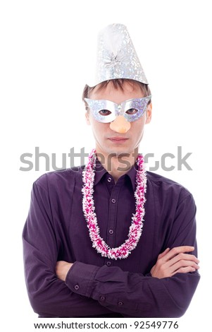 Serious man wearing party mask, isolated on white background.