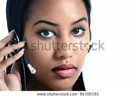 Serious office worker listening on headset