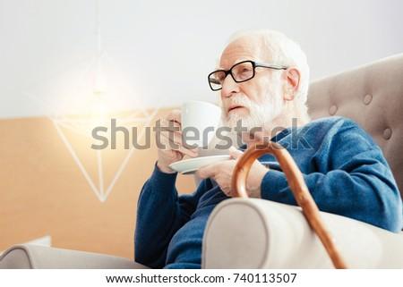 Serious pensioner having morning relax
