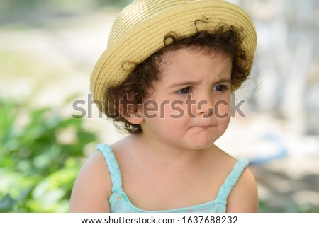 Serious pensive clever cute kid girl looking away lost in thoughts having question, feeling curious, melancholic or bored