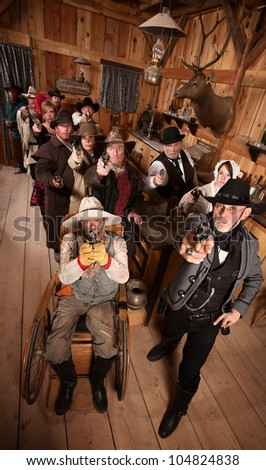 Serious people in old west saloon pull out their weapons