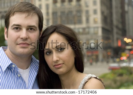 Serious pose of man and woman embracing