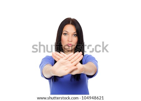 Serious pretty woman making stop hand sign palm gesture, isolated over white background