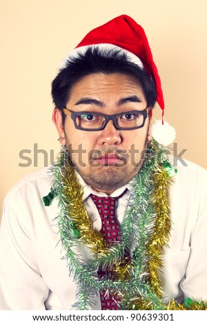Serious Santa, Business male model with rainbow  paper acting serious Santa.