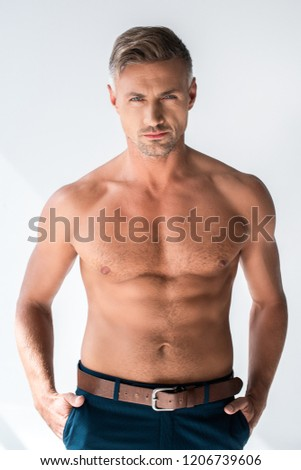 serious shirtless macho looking at camera isolated on white