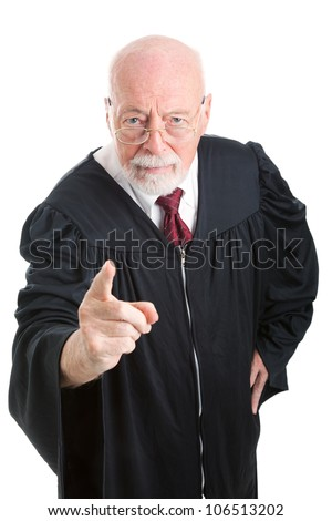Serious, stern judge pointing his finger at the camera.  Isolated on white.