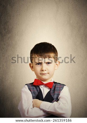 Serious,Stubborn,sad,upset  little boy,child  isolated over yellow background.Facial expression