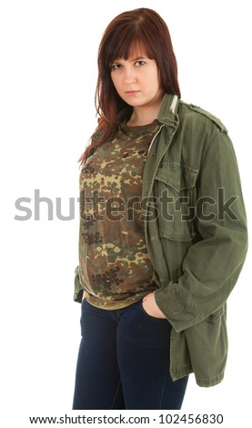 serious teenage girl in military jacket, white background