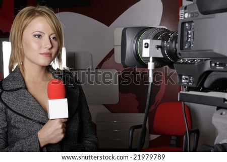serious TV reporter in live transmission  looking at the video camera