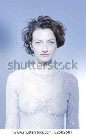 Serious woman on blue background, indoors