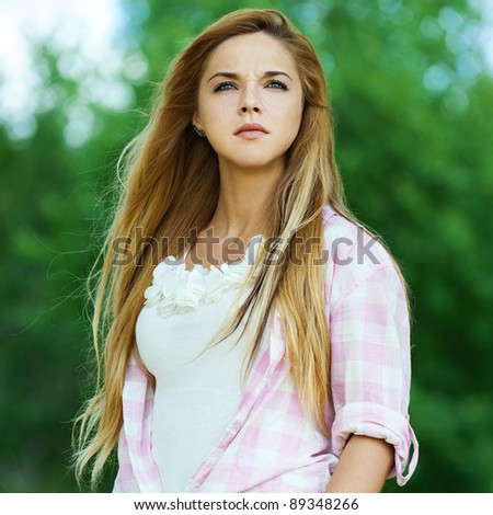 serious woman young beautiful park your hands pocket