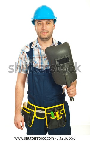 Serious workman holding mask isolated on white background